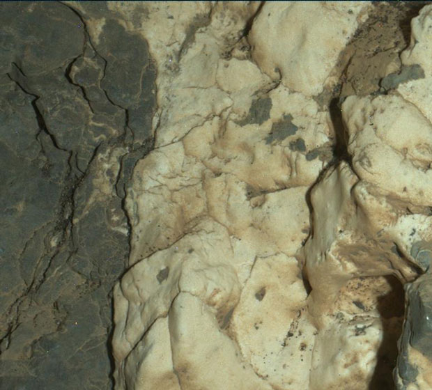 """This view from the Mars Hand Lens Imager on the arm of NASA's Curiosity Mars rover is a close-up of a two-tone mineral vein at a site called """"Garden City"""" on lower Mount Sharp. It was taken during night, illuminated by LEDs, on March 25, 2015. Image: NASA/JPL-Caltech/MSSS."""