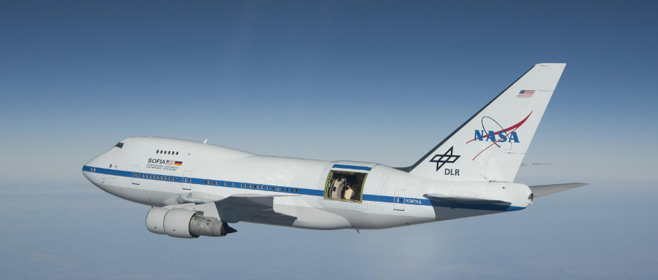 The Stratospheric Observatory for Infrared Astronomy (SOFIA) is a joint project of NASA and the German Aerospace Center (DLR). It is a Boeing 747SP wide-body aircraft that has been modified to include a large door in the aft fuselage that can be opened in flight to allow a 2.5-metre (100-inch) diameter reflecting telescope access to the sky. This telescope is designed for infrared astronomy observations in the stratosphere at altitudes of about 41,000 feet (12 kilometres). Image credit: NASA / Jim Ross.