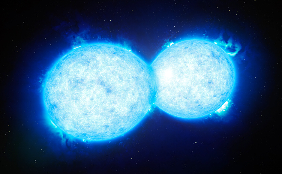 This artist's impression shows VFTS 352 — the hottest and most massive double star system to date where the two components are in contact and sharing material. The two stars in this extreme system lie about 160,000 light-years from Earth in the Large Magellanic Cloud. This intriguing system could be heading for a dramatic end, either with the formation of a single giant star or as a future binary black hole. Image credit: ESO/L. Calçada.