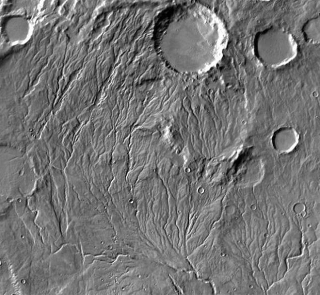 How much water is enough? Using NASA data and information on drainage tunnels and sediment flux from the Texas Department of Transportation, researchers calculated that carving ancient Martian valleys might have required less water than previously thought. Image credit: NASA/JPL-Caltech/Arizona State University.
