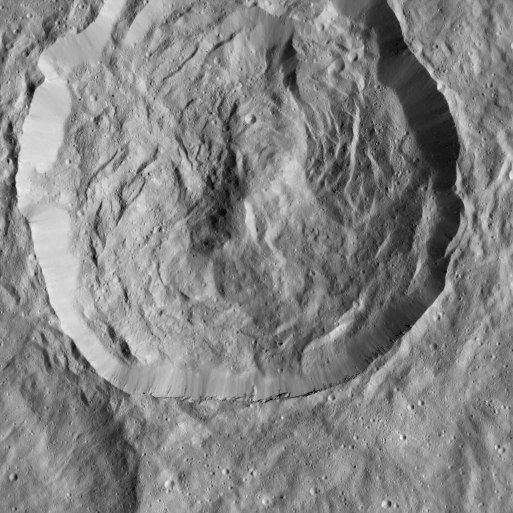 NASA's Dawn spacecraft viewed this Cerean crater, which is covered in ridges and steep slopes, called scarps on 23 December 2015. These features likely resulted when the crater partly collapsed during its formation. The curvilinear nature of the scarps resembles those on the floor of Rheasilvia, the giant impact crater on Vesta, which Dawn orbited from 2011 to 2012. The 20-mile-wide (32-kilometre-wide) crater is located just west of the larger, named crater Dantu, at northern mid-latitudes on Ceres. Both of these impact features were captured during Dawn's Survey orbit. Image credit: NASA/JPL-Caltech/UCLA/MPS/DLR/IDA.
