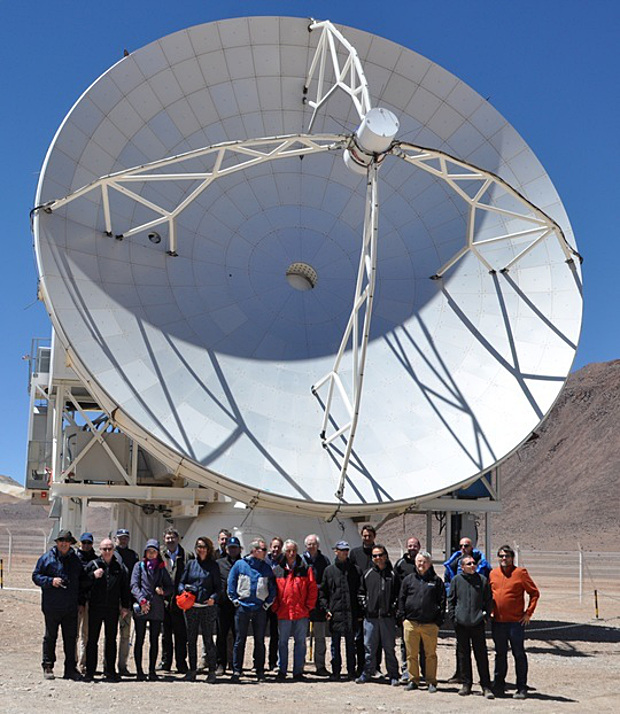 Guests of the event visiting the 12-metre APEX telescope, 5100 metres above sea level in the Chilean Atacama Desert. Image credit: ESO (APEX telescope).