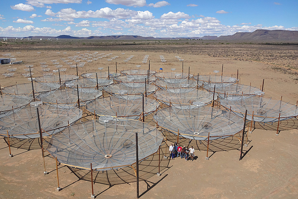 The Hydrogen Epoch of Reionisation Array (HERA) in South Africa consisted of 19 dishes on 7March 2016, but continues to grow, replacing an earlier experiment called PAPER (small dishes in the background). Image credit: the HERA team.