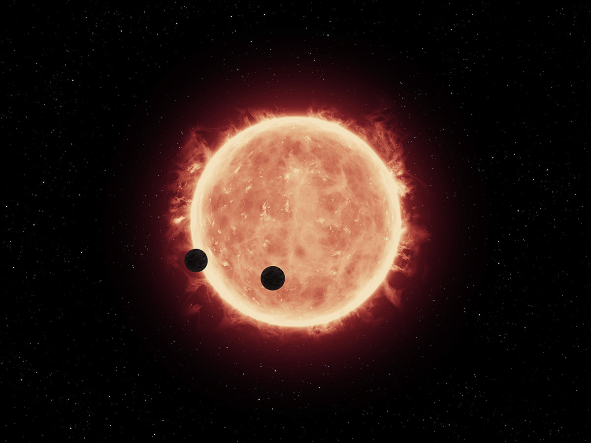 Artist's impression of Earth-sized planets orbiting a red dwarf star. Image credit: NASA, ESA, and G.Bacon (STScI).