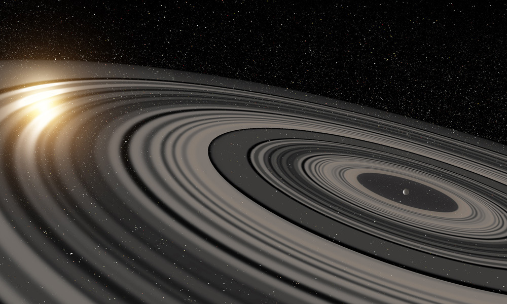 Artist's impression of the extrasolar ring system circling the young giant planet or brown dwarf J1407b. The rings are shown eclipsing the young Sun-like star J1407, as they would have appeared in early 2007. Illustration credit: Ron Miller.