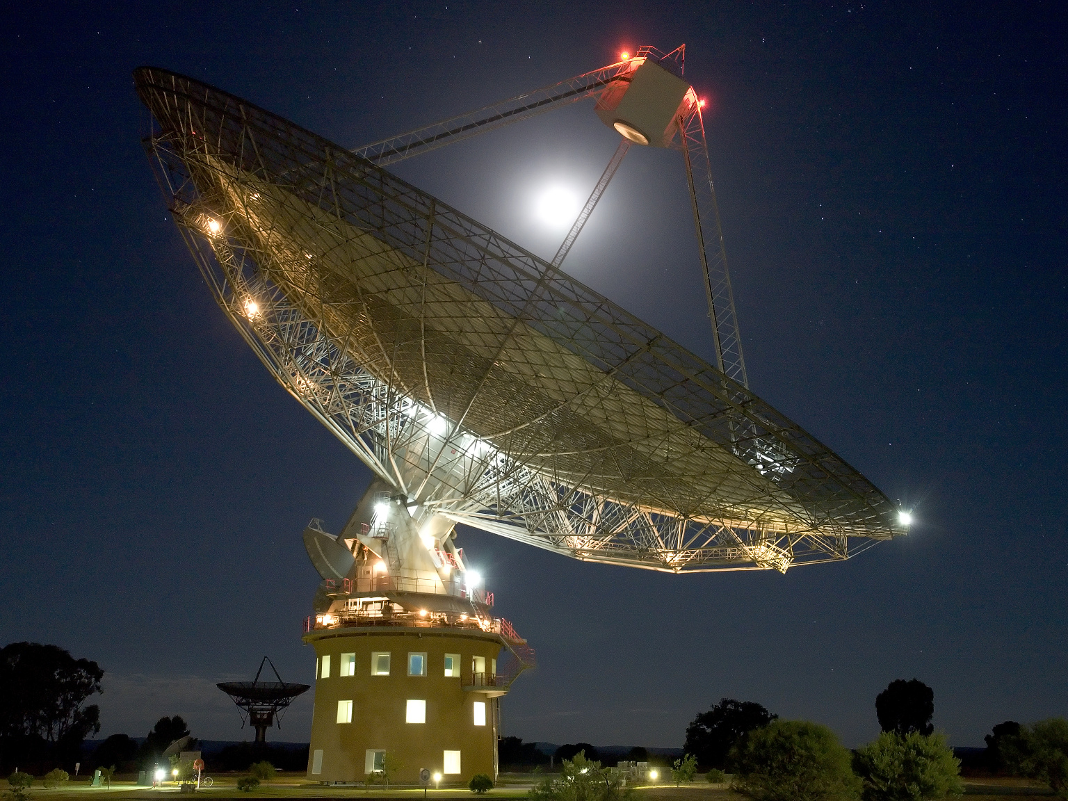 """The 64-metre-wide Parkes Radio Telescope in New South Wales, Australia is affectionately known as """"The Dish."""" It played an iconic role in receiving the first deliberate transmissions from the surface of another world, as the astronauts of Apollo11 set foot on our Moon. Now, Parkes joins once again in expanding human horizons as we search for the answer to one of our oldest questions: Are we alone? Image credit: Parkes Radio Telescope © 2005 Shaun Amy."""